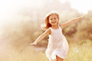 65781601 - little girl running in country field in summer